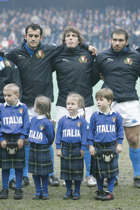 Italian Rugby Team players with mascots dressed in the Italian National Tartan kilts at Murrayfield 2005 for the RBS Six Nations