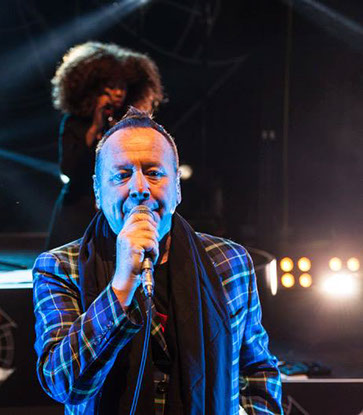 Jim Kerr wearing Italian National Tartan jacket on Simple Minds tour in Lisbon