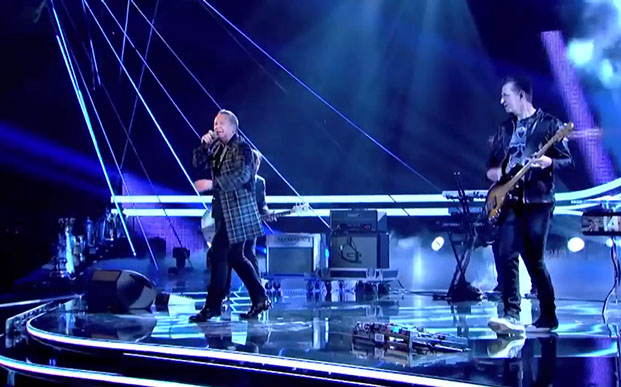 Simple Minds frontman Jim Kerr wearing Italian National tartan jacket